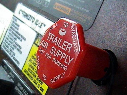 The Trailer Air Supply Valve is a red, 8-sided button on the dash. It supplies air to the trailer from the towing unit.
