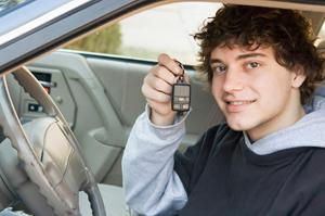 A young student successfully passes his road test and earns his license.