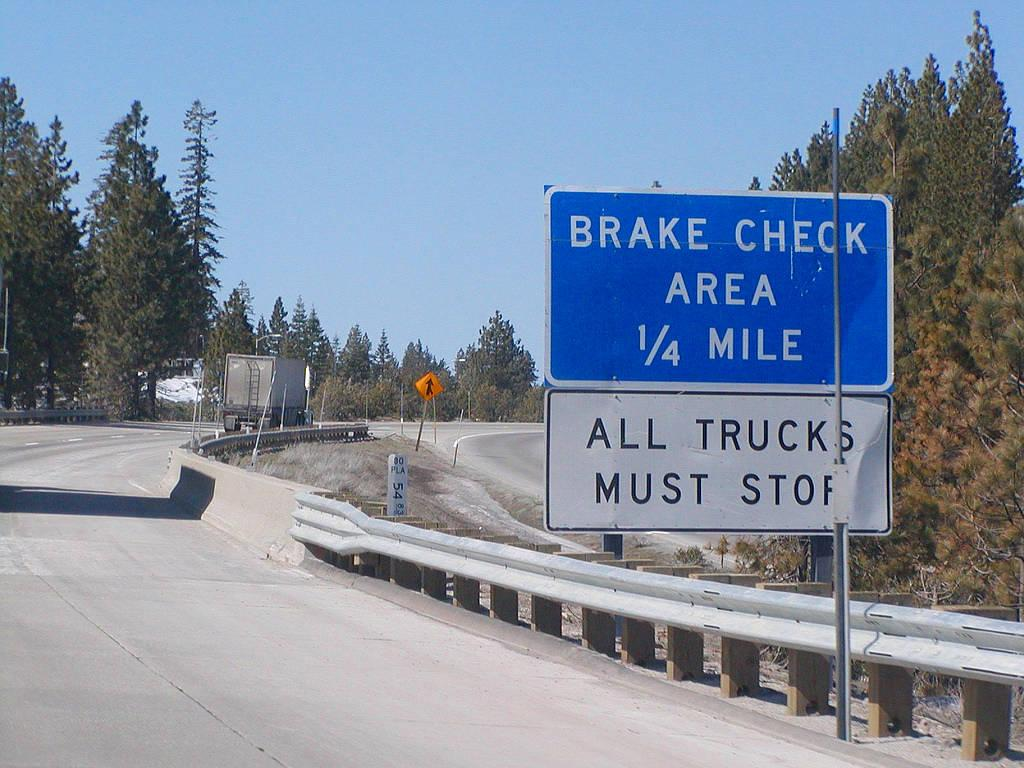 Although a different colour and shape, these sign locating brake check areas are regulatory signs and MUST be obeyed by CDL drivers of large vehicles.
