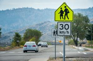 School speed zones are applicable only when school is in session. During Christmas and summer holidays, you don't obey these signs.