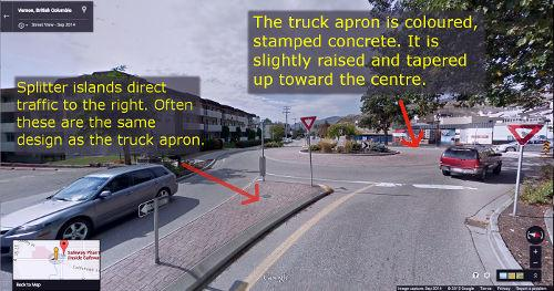 Small roundabout with truck apron designed to provide extra space for larger vehicles that are turning.