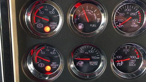 All air brake equipped vehicle must be fitted with a low-air warning. In this day-and-age, all low-air warning devices are a light and buzzer. The low-air warning activates above 60 pounds per square inch.