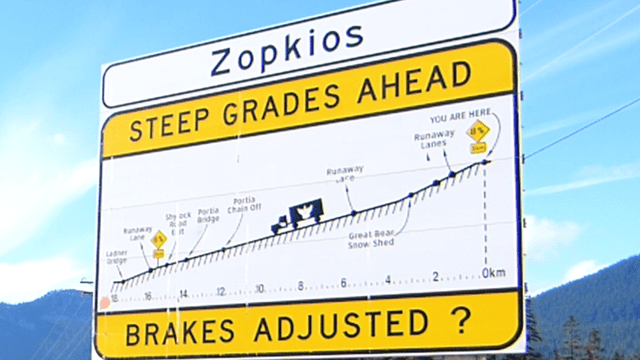 "The Zopkios ""Steep Grade Ahead"" sign board provides crucial information for drivers of large vehicle to safely descent one of Canada's most challenging dowhill descents."