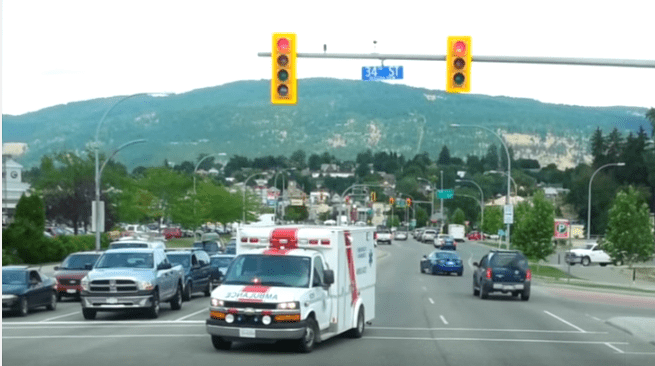 On a road test and all other times, drivers must move to the nearest shoulder and come to a stop until the emergency vehicle has passed. If in a roundabout or intersection, pull through or turn and stop.