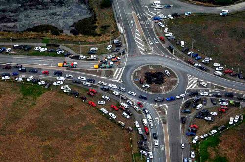 When navigating multi-lane roundabouts, think of it like a conventional intersection to be in the appropriate lane for proceeding straight or turning. Larger vehicles should stay in the outsdie lane.