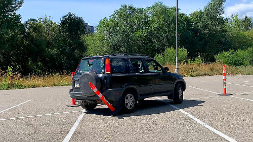 If you hit a cone when parallel parking on your driver's test, it's an automatic fail. Better to be a bit off, than strike the cone...go SLOW!