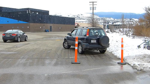 When parallel parking with cones, you'll bring the front end into the space when the front cone is just past the 'A' pillar on the passenger's side. This part may require adjustment depending on your vehicle.